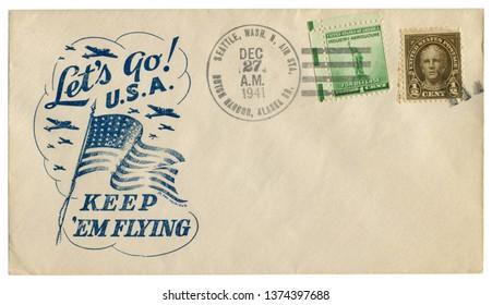 Dutch Harbor, Alaska, the USA - 27 Dec 1941: US historical envelope: cover with patriotic cachet Let's go U.S.A. Keep 'em flying and two postage stamp for defence, Nathan Hale, postal cancellation