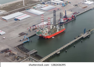 Dutch harbor Eemshaven with crane platform for installing offshore wind turbines at sea