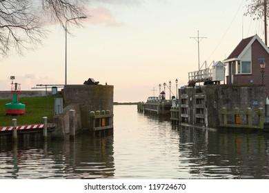 Dutch harbor entrance at sunset.