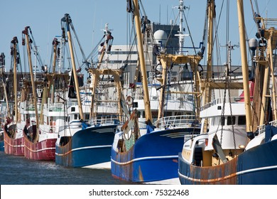 Dutch harbor of IJmuiden with modern fishing cutters