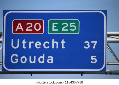 Dutch highway sign on motorway A20 E25 the kilometer distance to the city of Gouda and Utrecht.