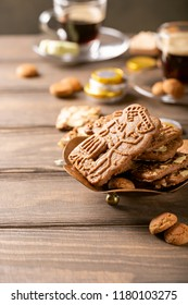 Dutch holiday Sinterklaas traditional sweets gingerbread cookies, speculaas koekjes, st. Nicolas day concept on december the fifth. Copy space.