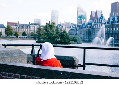 Dutch immigration politics, muslim citizen in front of The Hague, binnenhof, parliament of The netherlands