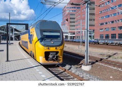 Dutch intercity train leaving the central station of Amersfoort, The Netherlands