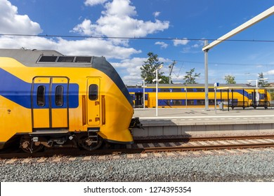 Dutch Intercity trains at the platform of a train station in The Netherlands.
