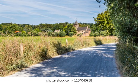 Dutch landscape with an ancient Roman church and a road  in Oosterbeek in the Netherlands