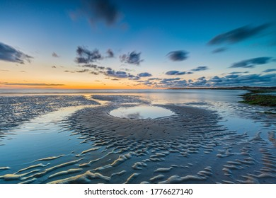 Dutch landscape and beach at sunset. Brouwersdam, Zeeland