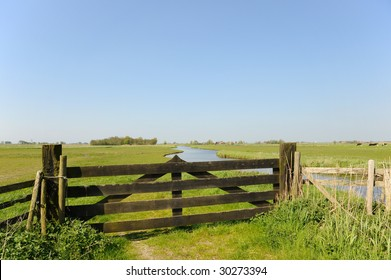 Dutch landscape with fence in polder