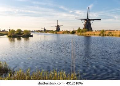 Dutch landscape with windmills, blue sky and water at Kinderdijk, Netherlands