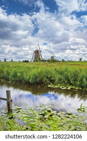 Dutch landscape with windmills in a field and dramatic clouds