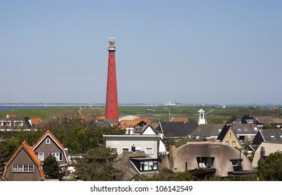 dutch lighthouse with blue sky