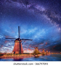 Dutch mill at night. Starry sky. Holland. Netherlands.