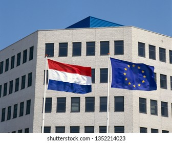 The Dutch national flag together with the flag of the European Community