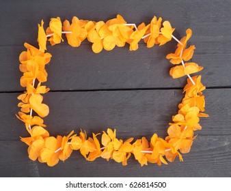 Dutch orange flower necklace on wooden background
