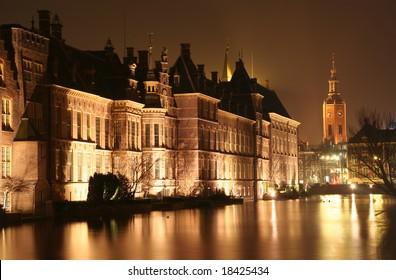 Dutch parliament Binnenhof and church tower at night