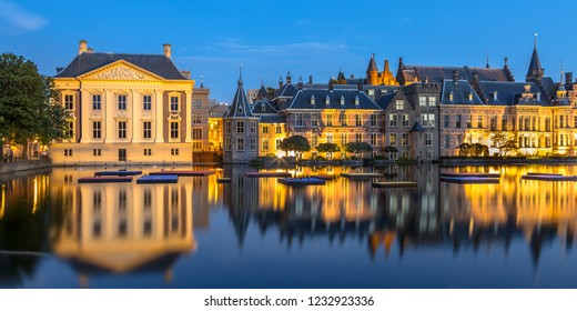 Dutch parliament building Binnenhof seen from Hofvijver at night