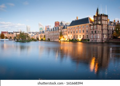 Dutch parliament buildings Binnenhof with skyscrapers in the background in Hague, Netherlands, during sunset