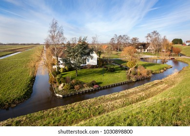 Dutch polder landscape with a farm and some houses in Capelle aan den IJssel in the Netherlands