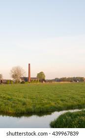Dutch pumping station in polder landscape