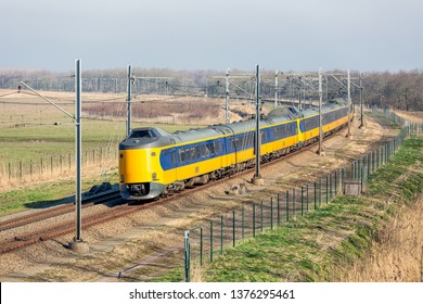 Dutch railway with express train through National Park Oostvaardersplassen between Lelystad and Almere