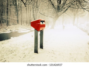 dutch red post box by winter