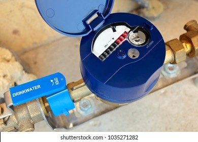 Dutch residential water meter with the text 'drinking water' on the tap