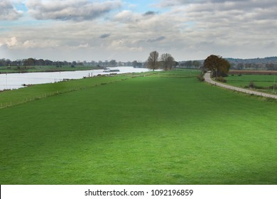 Dutch River landscape scene with nice sunlight spot on the grass in front