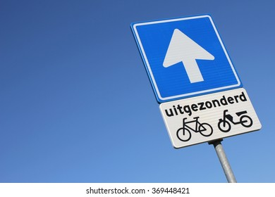 Dutch road sign: one-way street (translation: except)