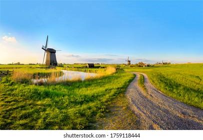 Dutch rural windmll farm road landscape. Windmill farm road view. Windmill farmland road landscape