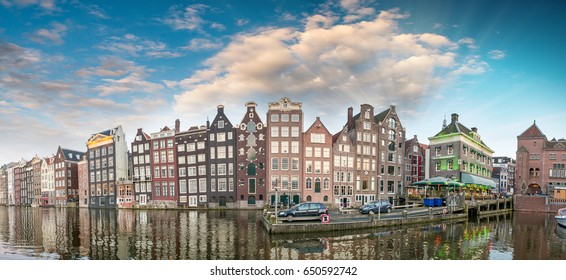Dutch scenery with its canal side houses. Amsterdam panoramic skyline.