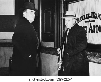 Dutch Schultz (right) and James L. Nooman, his attorney, visit the Dist. Atty. of Troy, New York. Schultz was sought for several days by Troy authorities investigating the death of Jules Martin, a NYC