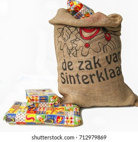 "Dutch Sinterklaas celebration with a big bag filled with presents (translation on bag "" the bag of Sinterklaas eg Saint Nicholas)"