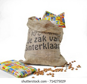 "Dutch Sinterklaas celebration with a big bag filled with presents (translation on bag "" the bag of Sinterklaas eg Saint Nicholas) and ginger cookies"