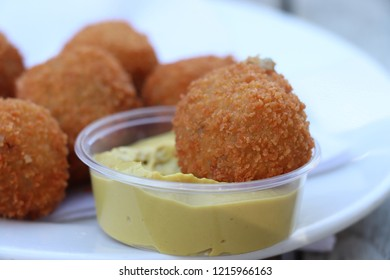 "Dutch snack: Bitterballen with mustard. Warm stuffed fried meatballs, often served with alcoholic drinks as ""bittergarnituur"", a Dutch name for snacks"