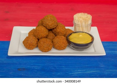 Dutch snack bitterballen on a red white and blue background