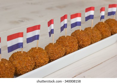 Dutch snacks with little dutch flags in a long white dish