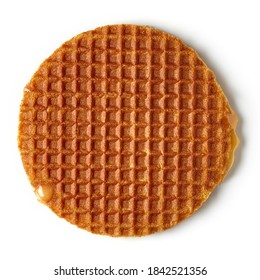 Dutch stroopwafel with caramel and honey isolated on white background, top view
