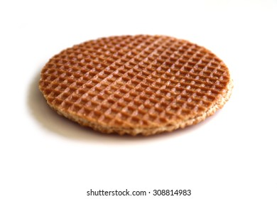 Dutch syrup waffle (stroopwafel), on a white background.