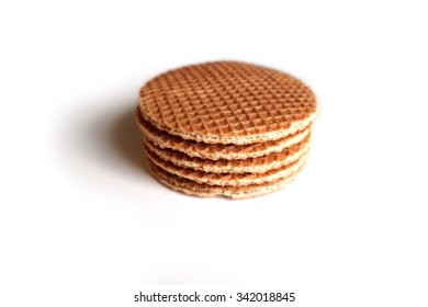 Dutch syrup waffle (stroopwafel) stack, on a white background