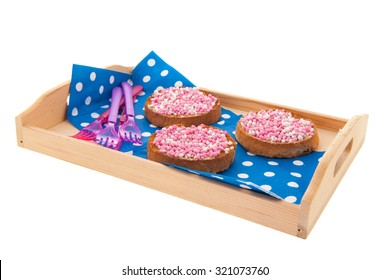 Dutch tradition while baby born with beschuit and muisjes isolated over white background