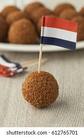 Dutch traditional snack bitterballen with a dutch flag cocktail stick