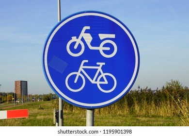 Dutch traffic road sign for moped and bicycle path or cycle lane (Dutch: brommer- en fietspad)