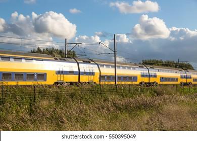 Dutch train in rural landscape