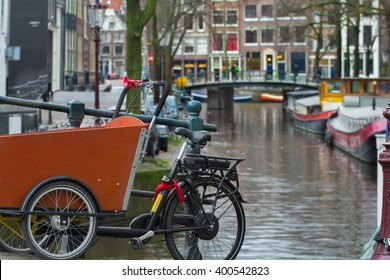 Dutch urban landscape of Amsterdam street canal with bridge and houses background