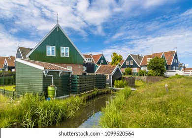 Dutch village scene with wooden houses and canal on the island of Marken in the Ijsselmeer or formerly Zuiderzee, the Netherlands