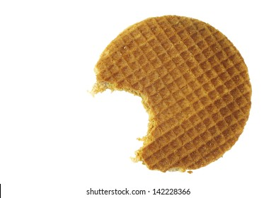 Dutch waffle called a stroopwafel with a bite missing on a white background