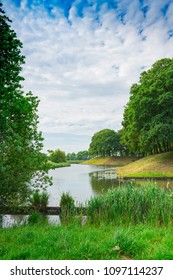 dutch water landscape with dike and trees in fortified village Klundert, The netherlands