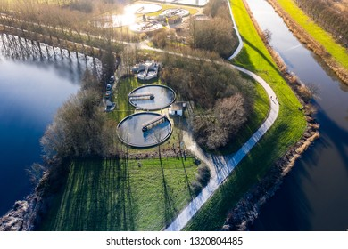 A dutch water treatment plant for cleaning the sewage water, seen from above during sunset. Near Waalwijk, Noord-Brabant, Netherlands.