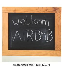 Dutch welkom Airbnb written on blackboard isolated over white background