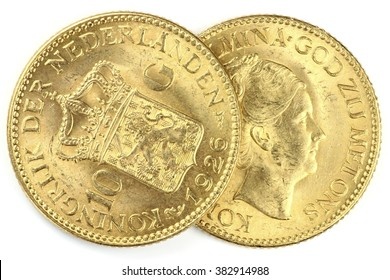 Dutch Wilhelmina gold coins isolated on white background (translation: Queen Wilhelmina - God be with us / Kingdom of the Netherlands)